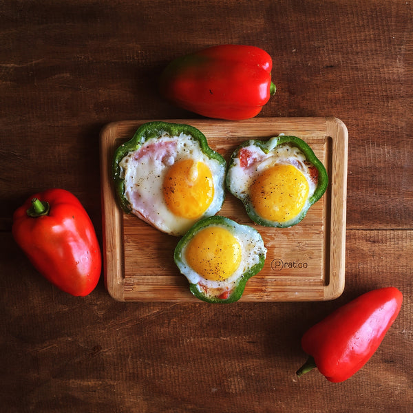 eggs fried with tomato in bell pepper