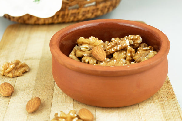 a bowl of almonds and walnuts