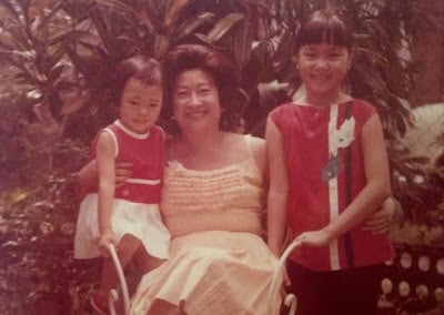 Besa-Quirino (right) with her mother Lulu Reyes (center) and sister.