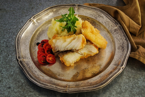 beer battered fried fish on a plate