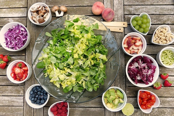 fruits and leafy vegetables on the bowls