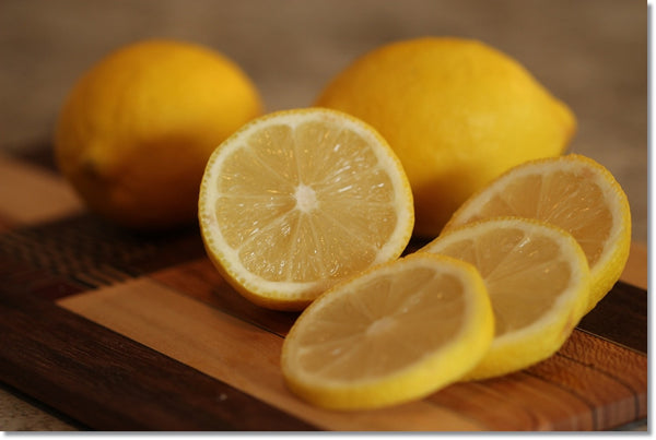 clean cutting board with lemon and salt