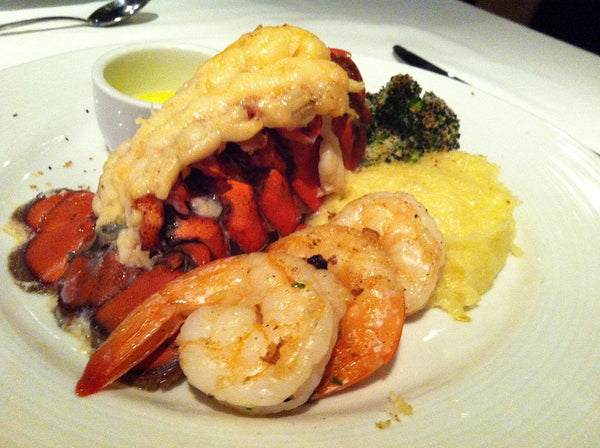 lobster tails with lemon garlic butter on a plate