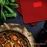 red silicone pot holders and pizza
