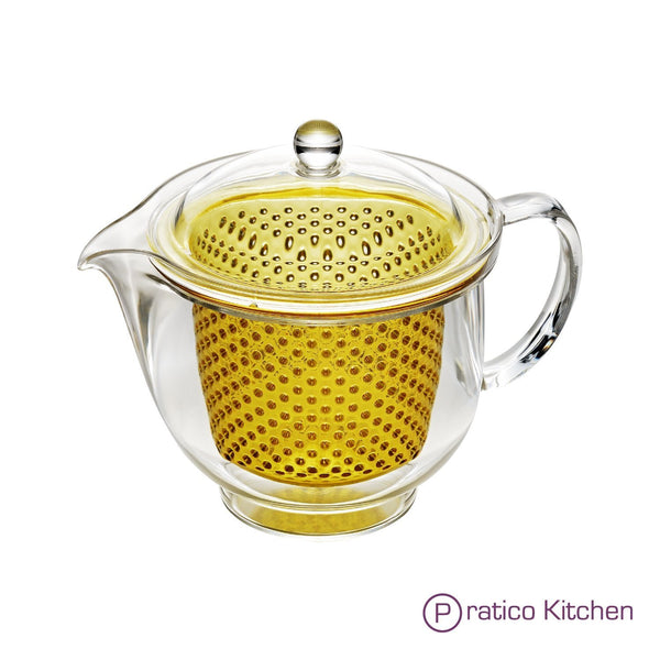 single serving teapot with yellow colored infuser