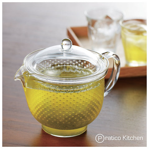 single serving teapot filled with brewed tea
