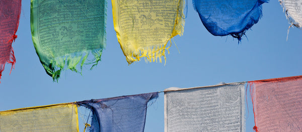 What are the prayers on a Buddhist prayer flag about?