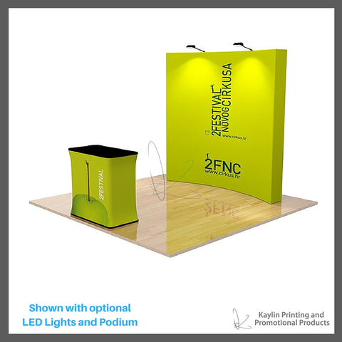 KYN-TSD-001 Trade Show Display with 8 foot curve shape and vibrant graphics printed on fabric. Velcro attached. Personalized with your custom imprint or logo. Shown with optional LED Lights and Podium.