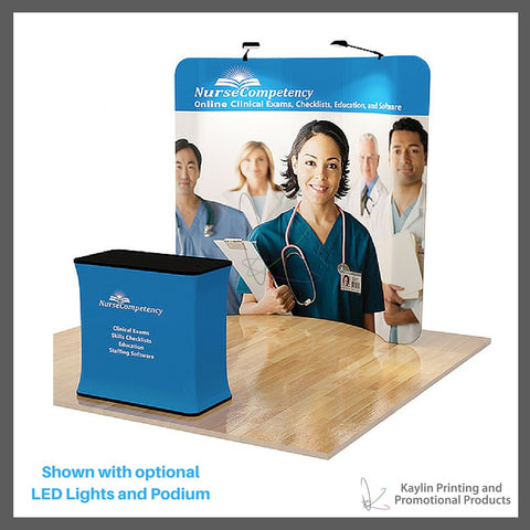 KYN-TSD-001 Trade Show Display with 8 foot curve shape and vibrant graphics printed on fabric. Personalized with your custom imprint or logo. Shown with optional LED Lights and Podium.