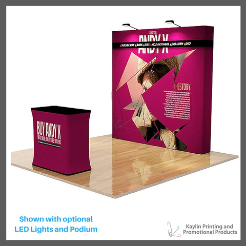 KYN-TSD-001 Tradeshow Display with 8 foot straight shape and vibrant graphics printed on fabric. Velcro attached. Personalized with your custom imprint or logo. Shown with optional LED Lights and Podium.