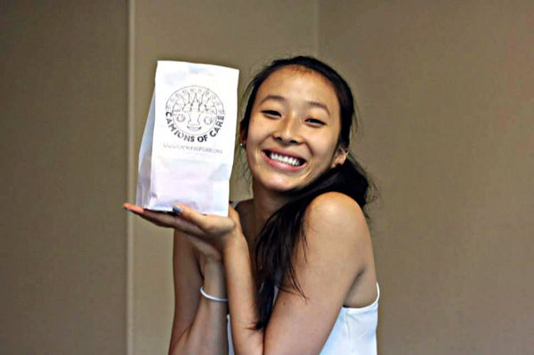 Nadya Okamoto holds a Camions of Care package.