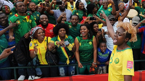 Fans support the Lioness football team in Cameroon.