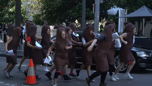 Women in sausage costumes storm the red carpet.