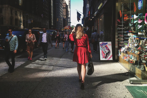 woman red dress walking in the city
