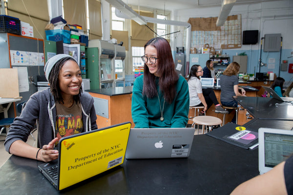 Two members of a Girls Who Code club.