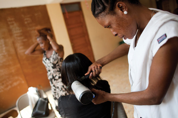 Female Hairdresser in Haiti.