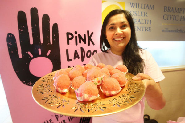 Harbir Singh holds a plate of Pink Ladoo's