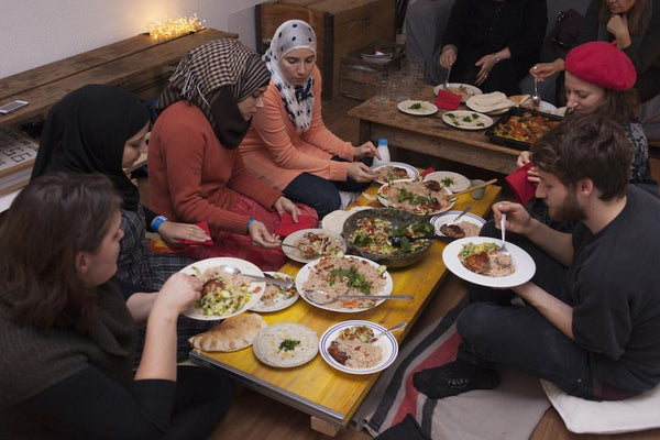 Dinner club in Berlin, with food prepared by displaced women from Syria.
