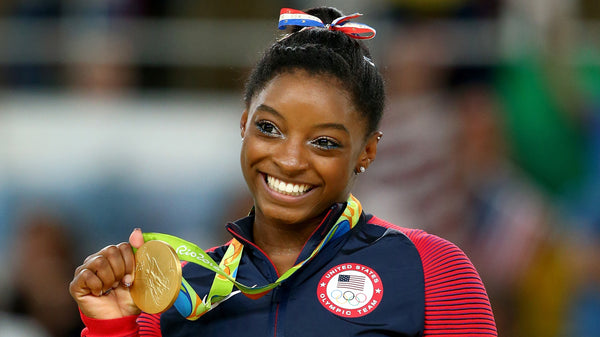 Simone Biles and one of her Gold Medals.