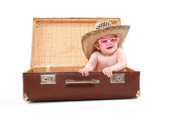 Travelling with a baby, newborn travel tips, advice for travelling with a baby, baby travel packing list, packing list for baby holiday, what to pack for baby