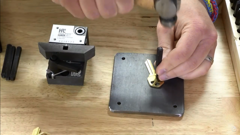 Key blank and stamping plate