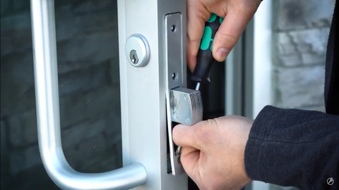 Pop lock plate off with a screw driver