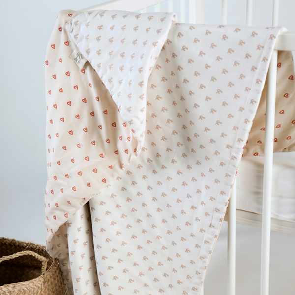 Oatmeal print and tabasco heart organic cotton baby blanket in drawstring bag