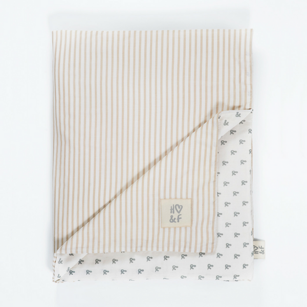 Oatmeal stripe and faded grey print organic cotton baby blanket in drawstring bag
