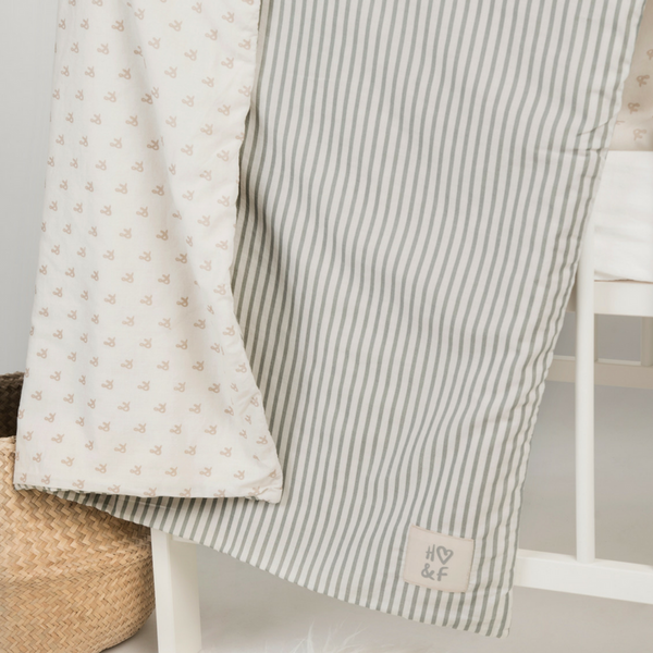 Faded grey stripe & oatmeal print organic cotton baby blanket.
