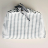 Faded grey stripe & oatmeal print organic cotton baby blanket in drawstring bag