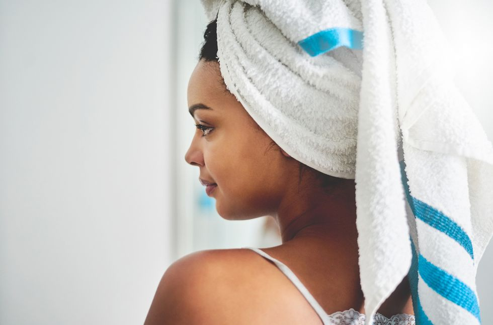 woman with white and blue towel wrapper around head