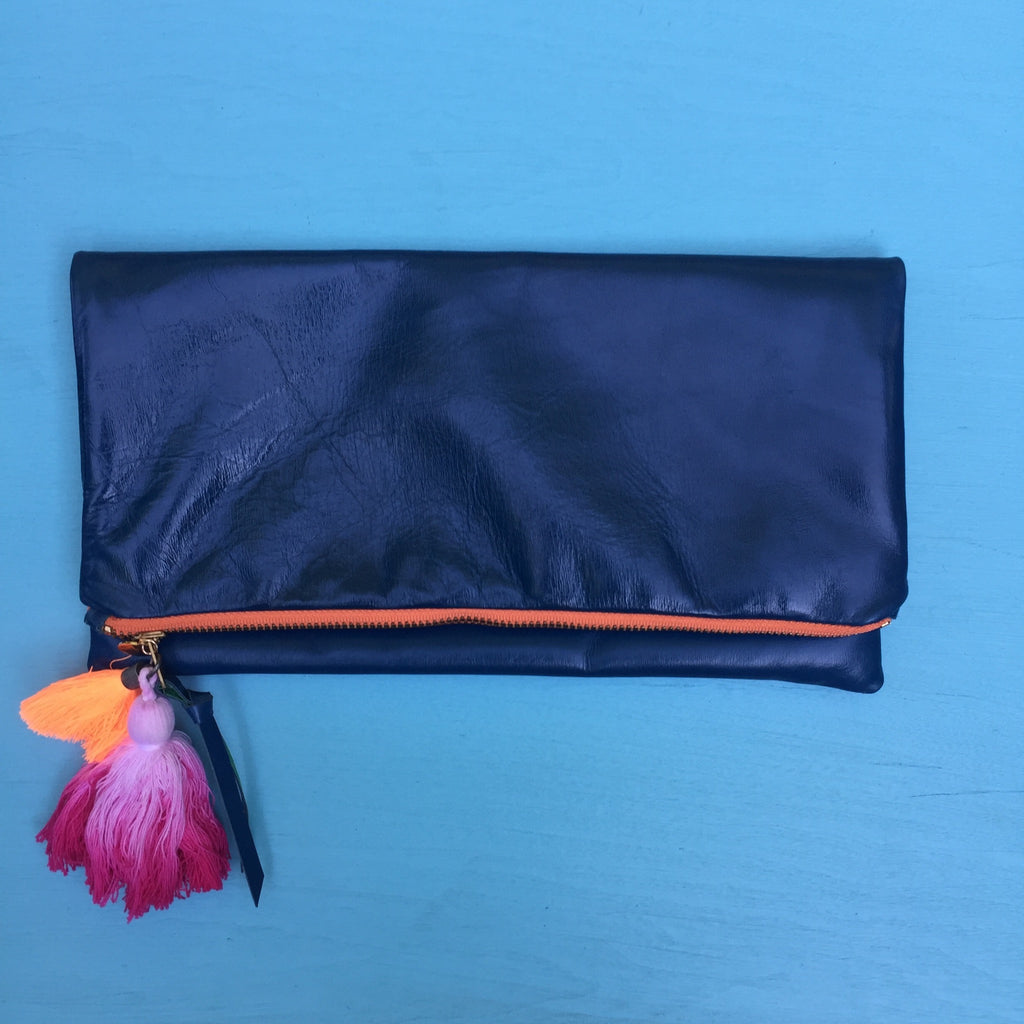 Blue clutch/orange zip
