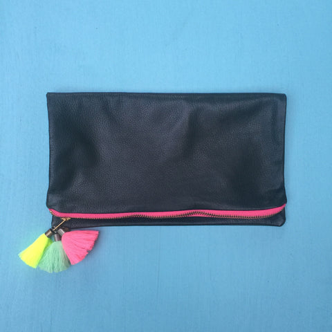 Green clutch/pink zip