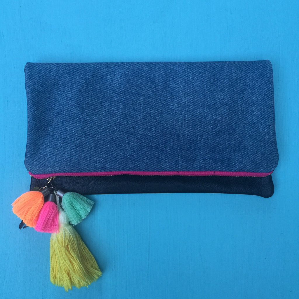 Denim and black leather clutch/hot pink zip