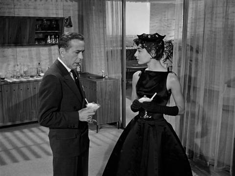 Audrey Hepburn in Sabrina black cocktail dress bateau neckline
