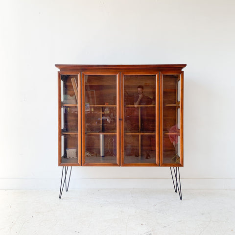 Mid Century Sculpted Curio with Glass Sides and Shelves
