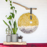 Round Woven Wall Hanging in Yellow + Grey on Driftwood