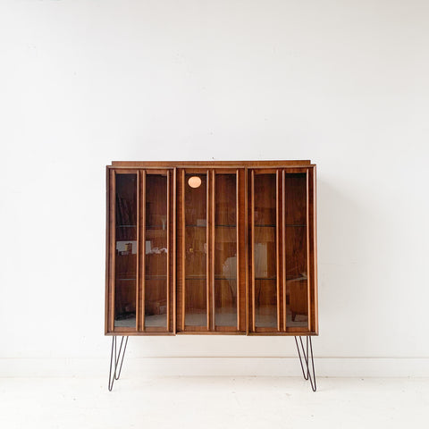 Mid Century Modern Sculpted Front Curio Cabinet with Glass Shelves
