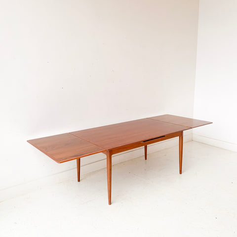 Mid Century Modern Danish Teak Expandable Dining Table by Arne Hovmand Olsen