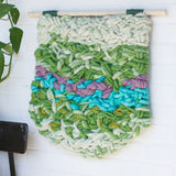 Green Woven Wall Hanging with Purple and Teal and Sparkles