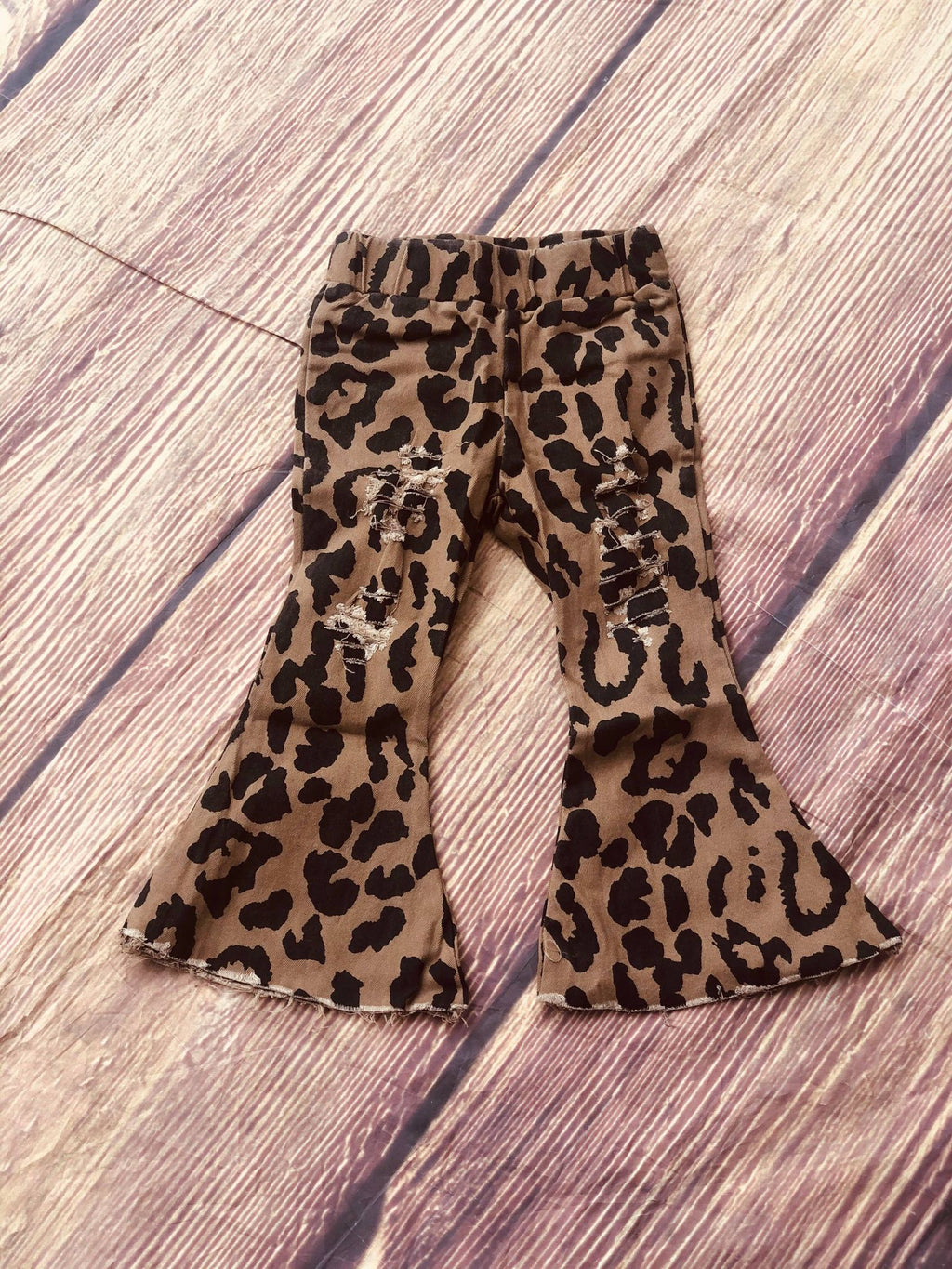 FLARE DISTRESSED JEANS - ANIMAL PRINT