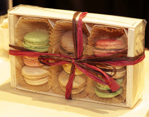 wooden gift crate packed with tom pouce and macrons