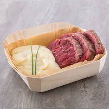 meat and potatoes served in panibois baking molds
