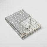 Grey merino wool blanket. Contemporary, geometric design. Woven in England.