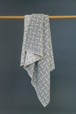 Grey, merino wool blanket. Contemporary, geometric design. Woven in England.