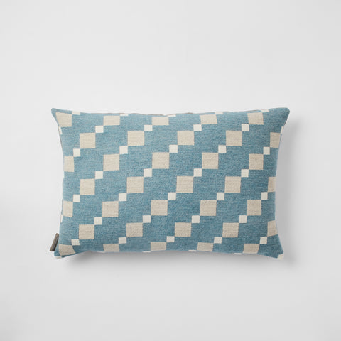 Contemporary merino wool cushions woven in England in a beautiful soft shade of Teal.