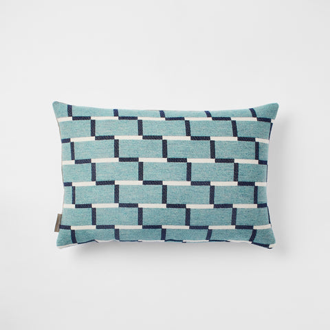 Contemporary merino wool cushion, teal and navy blue. Woven in England.