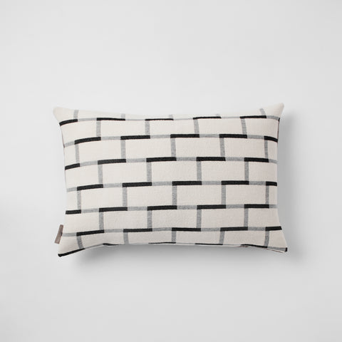 Contemporary, merino wool cushion. Geometric, monochrome design. Woven in England.