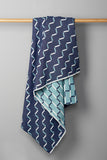 Contemporary, blue blanket. Merino wool, woven in England.