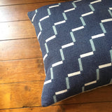 Contemporary, navy blue cushion. Merino wool, woven in England.